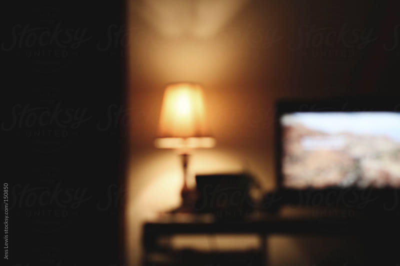 television and lamp in the evening by Jess Lewis for Stocksy United