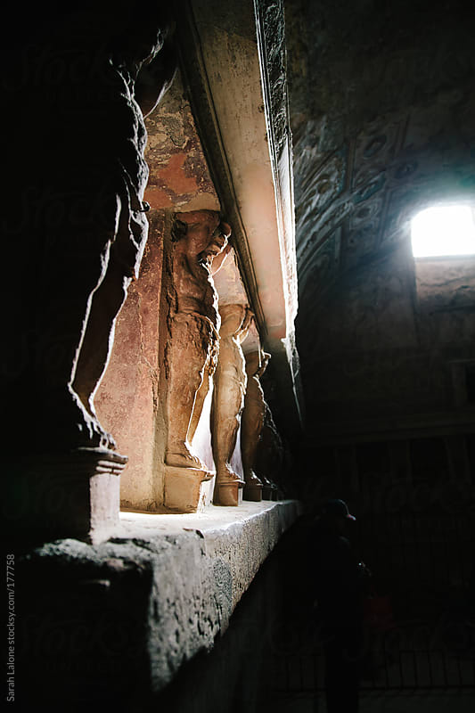 inside of a bath house in pompeii by Sarah Lalone for Stocksy United