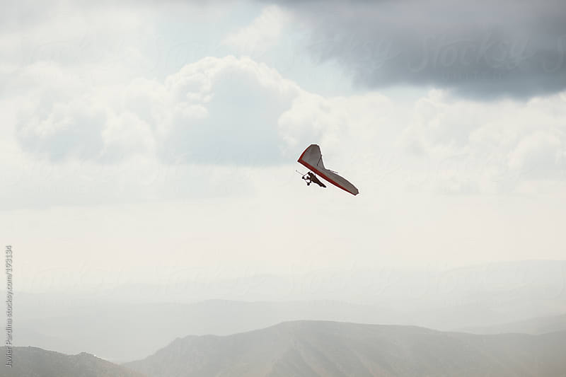 man practicing hang-glider by Javier Pardina for Stocksy United