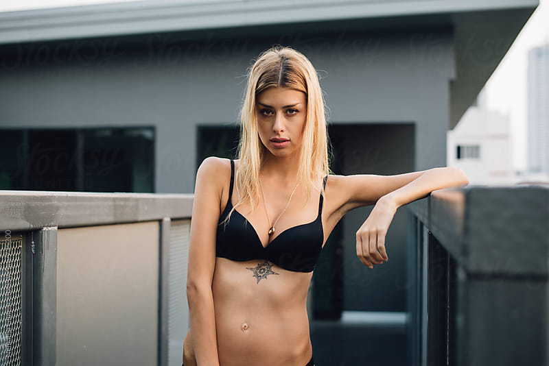 Attractive Blonde Model Posing In Black Bikini by Nemanja Glumac for Stocksy United