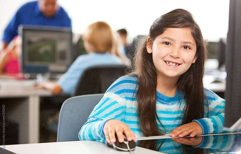 Computer Class: Cheerful Computer Student At Desk by Sean Locke for Stocksy United