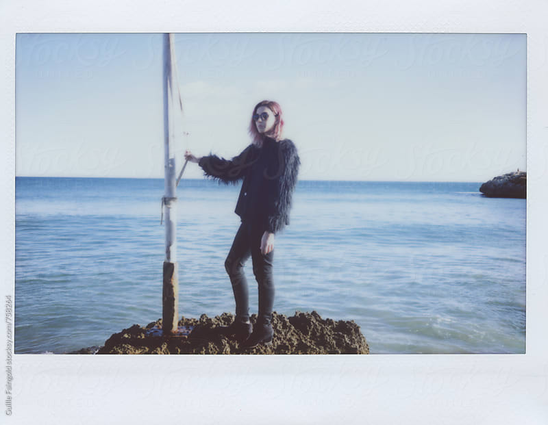 stylish woman near mediterranean sea by Guille Faingold for Stocksy United