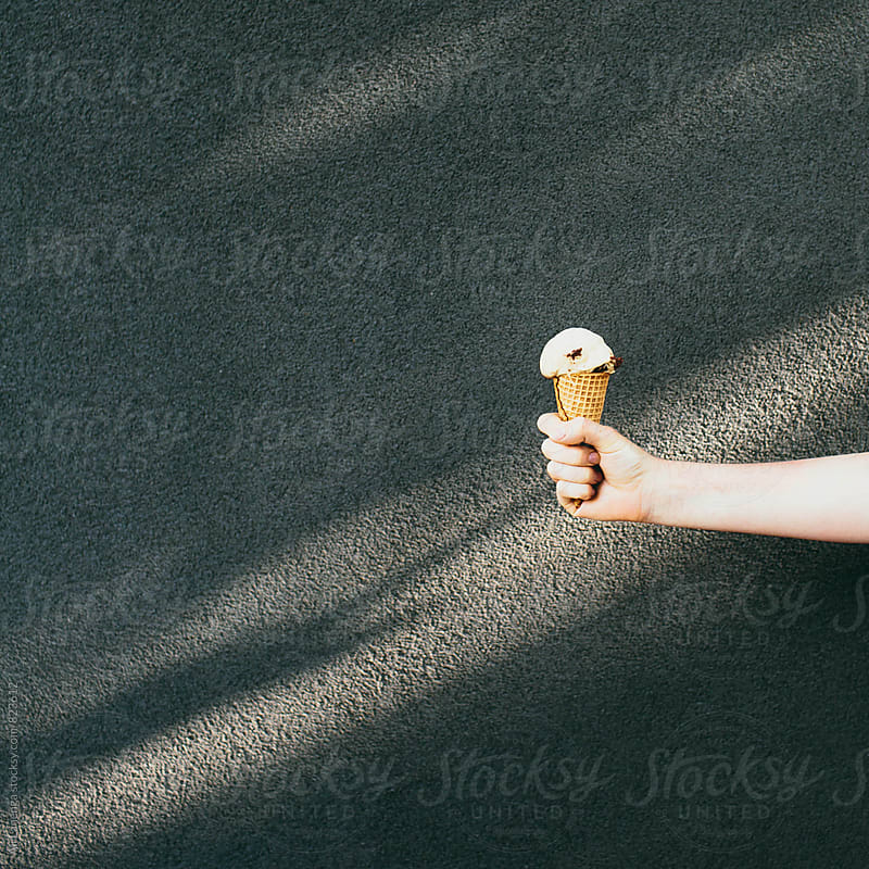 Ice cream hand by Ali Lanenga for Stocksy United