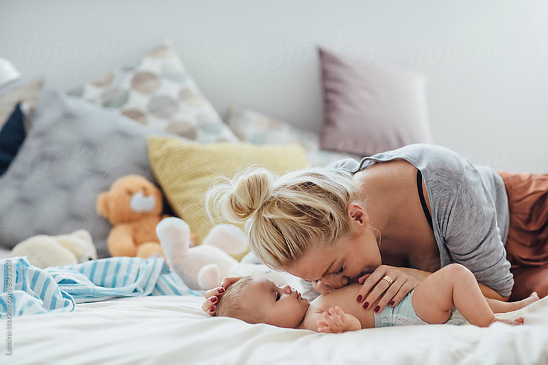 Mother Kissing Her Baby by Lumina for Stocksy United