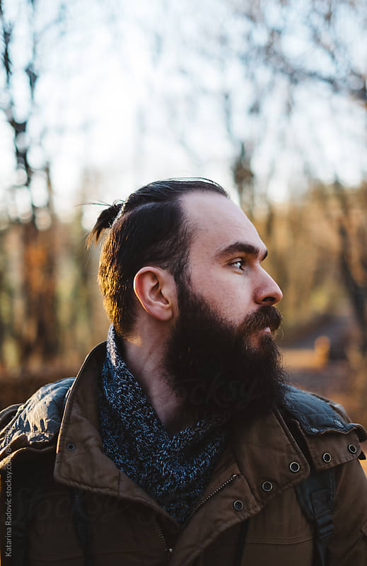 Portrait of a Handsome Man in a Woods by Katarina Radovic for Stocksy United