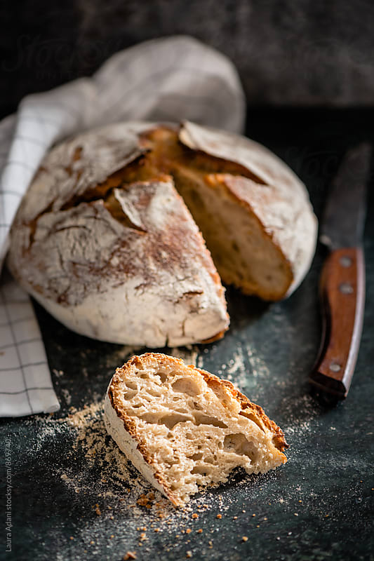 No-knead bread sliced by Laura Adani for Stocksy United