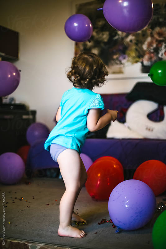 Playful little girl during birthday party by GIC for Stocksy United