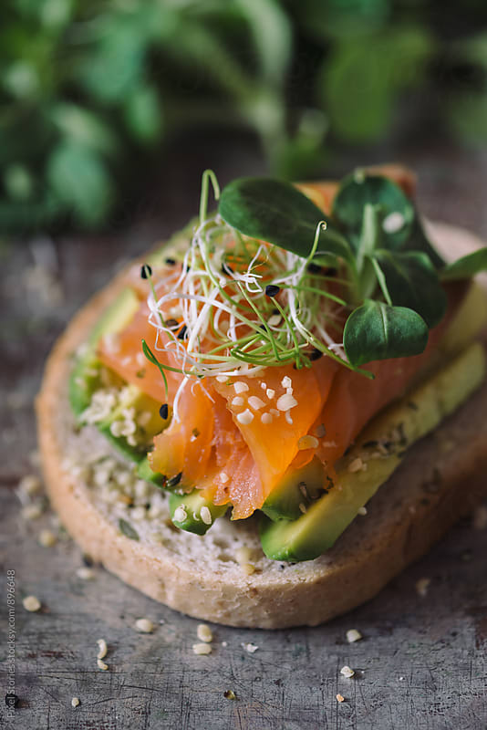 Salmon and avocado sandwich by Pixel Stories for Stocksy United