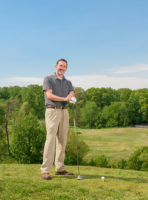 Mature Adult Man Standing In Tee Box on Golf Course by Brian McEntire for Stocksy United