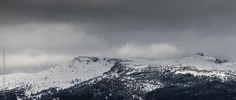 panorama of a snowy mountain in the storm by Javier Pardina for Stocksy United
