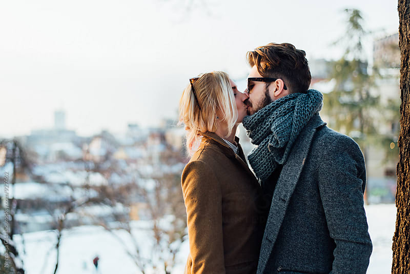 Couple Kissing On a Sunny Winter Day by Nemanja Glumac for Stocksy United