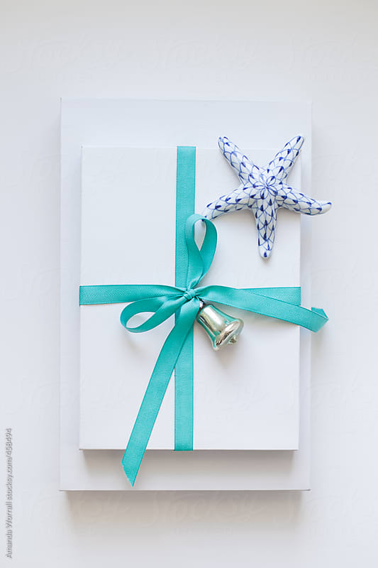 Christmas gift with beachy color scheme by Amanda Worrall for Stocksy United