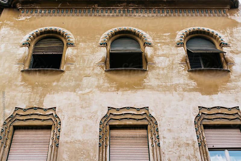 Windows at an old building in Romania by Gabriel (Gabi) Bucataru for Stocksy United