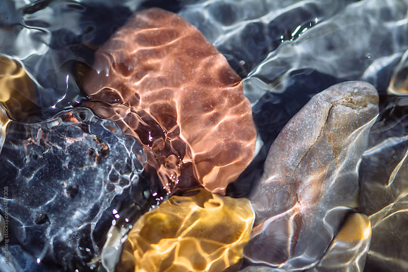 Abstract waves with stone by zheng long for Stocksy United