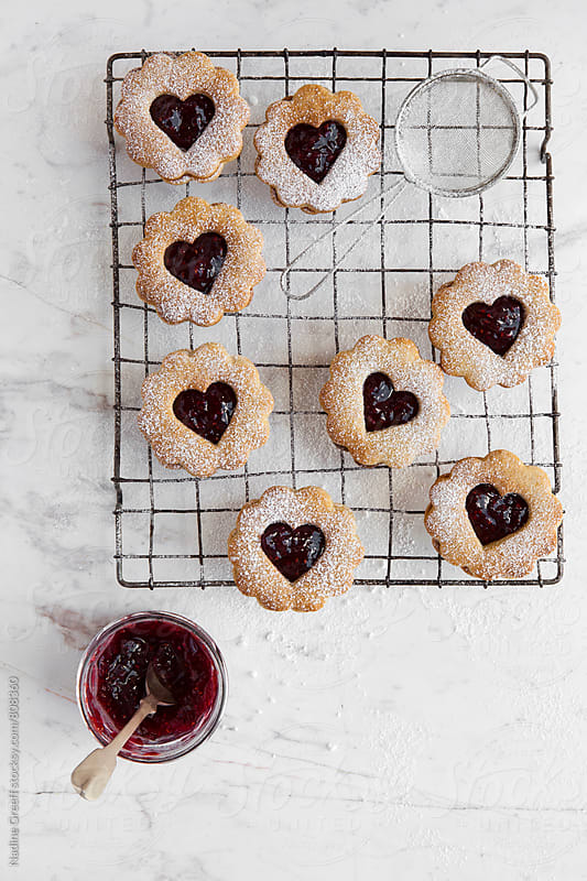 Cookies made with jam or jello filled hearts by Nadine Greeff for Stocksy United