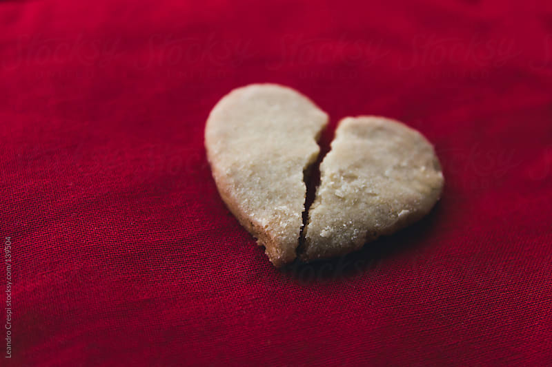 Heart shaped cookie broken by Leandro Crespi for Stocksy United