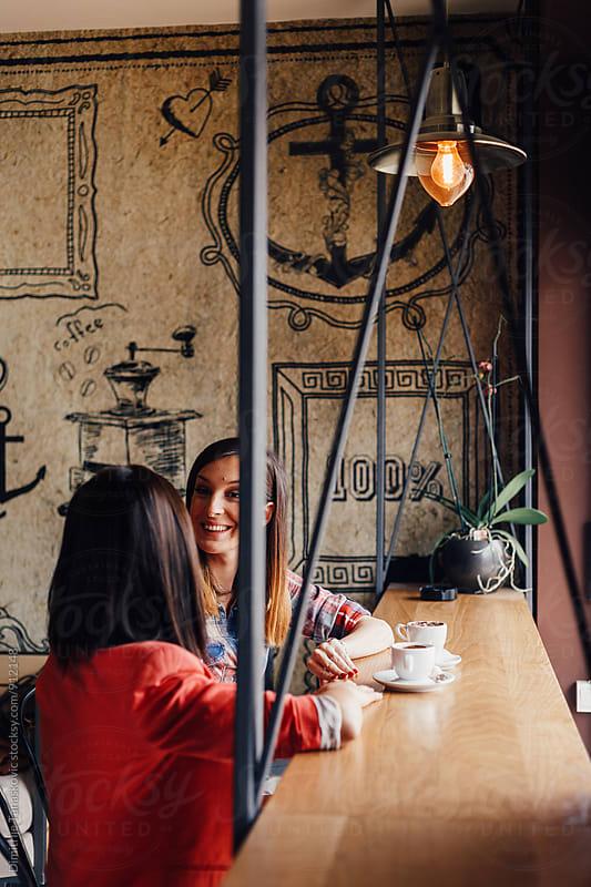 Friends in cafe by Dimitrije Tanaskovic for Stocksy United