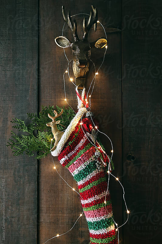 Closeup stripe wool stocking with lights by Sandra Cunningham for Stocksy United