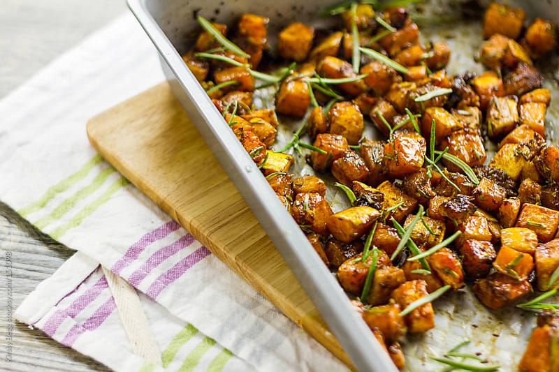 Roasted butternut squash on baking tray by Kirsty Begg for Stocksy United