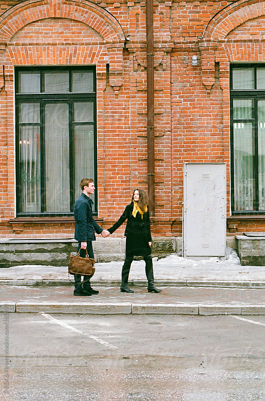 Young pair on the pavement by Danil Nevsky for Stocksy United