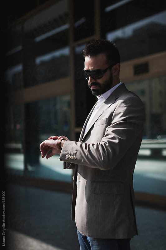 Businessman checking the time. by Mauro Grigollo for Stocksy United