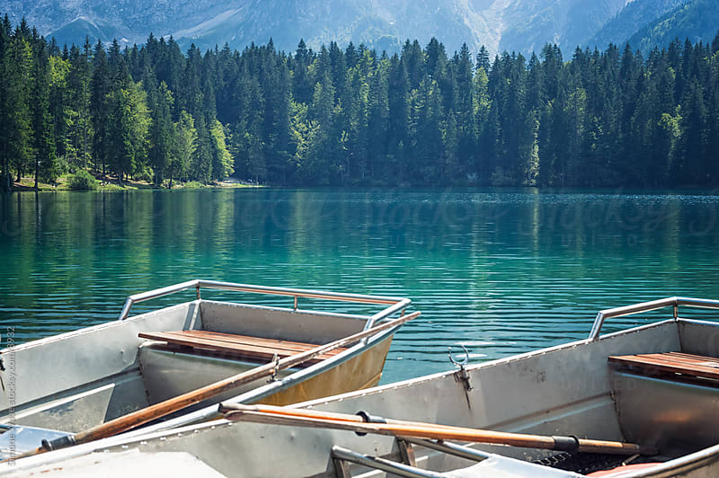 Wooden Boats in a Mountain Lake by Simone Becchetti for Stocksy United