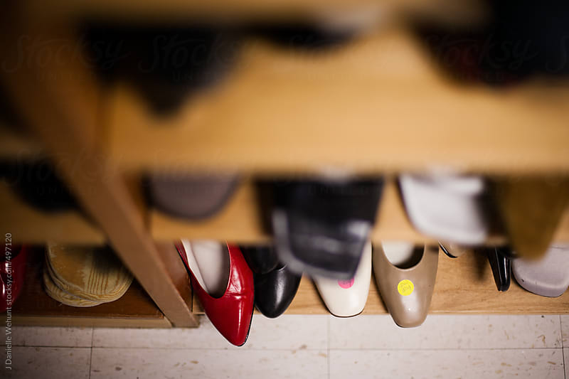 shoes on a shelf by J Danielle Wehunt for Stocksy United