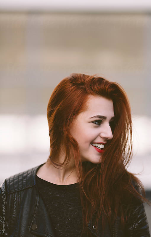 portrait of happy young woman with red hair by Alexey Kuzma for Stocksy United