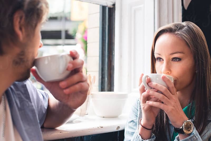 Couple in a Cafe by Aila Images for Stocksy United
