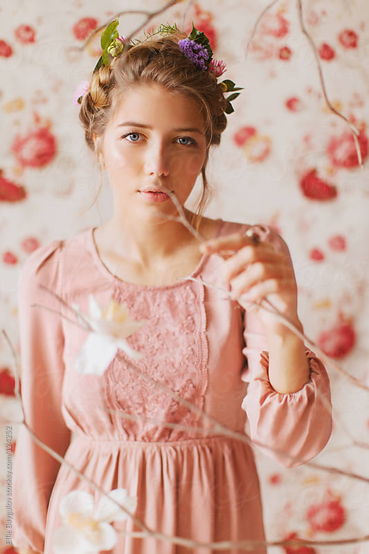 Young girl in pink dress by Ellie Baygulov for Stocksy United