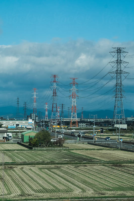 Power Pylons across the Japanese landscape by Rowena Naylor for Stocksy United