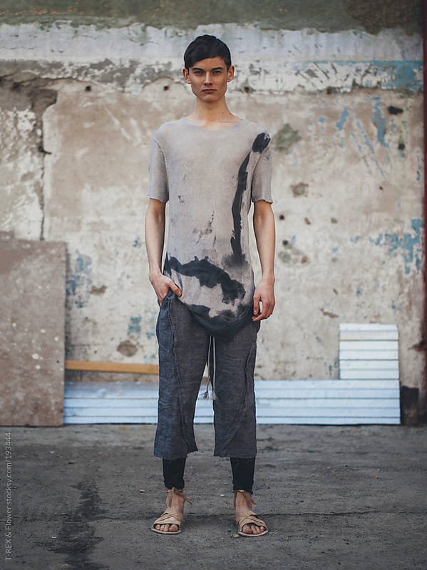 Angry young man in rugs by Danil Nevsky for Stocksy United