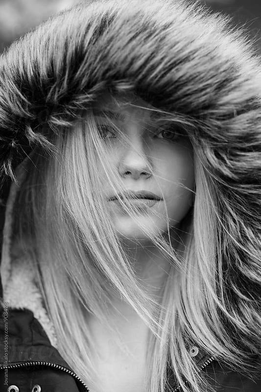Portrait of a young woman in the wind by Jovana Rikalo for Stocksy United
