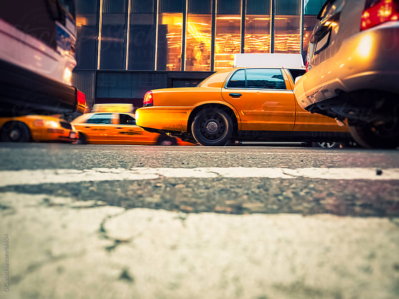 Traffic with taxis in New York City by Simone Becchetti for Stocksy United