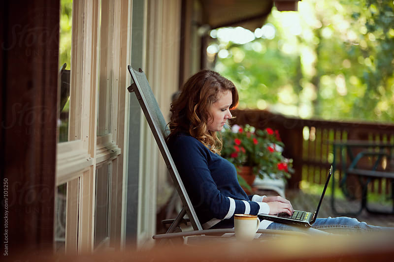 Working: Doing Business From Porch at Home On Laptop by Sean Locke for Stocksy United