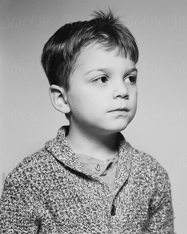 Film studio portrait of a young boy by Cameron Whitman for Stocksy United