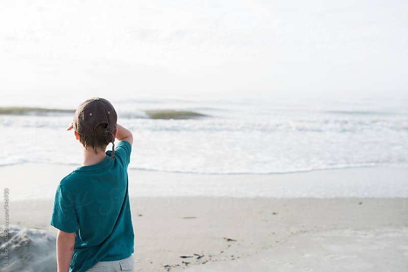 little kid by the sea and looking out by Léa Jones for Stocksy United