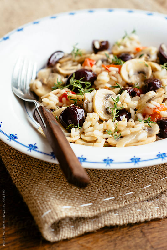 Mushroom Risotto with Black Olives by Harald Walker for Stocksy United