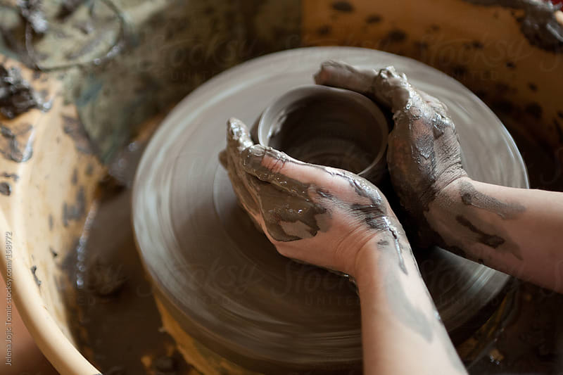Sculpting on electric pottery wheel by Jelena Jojic Tomic for Stocksy United