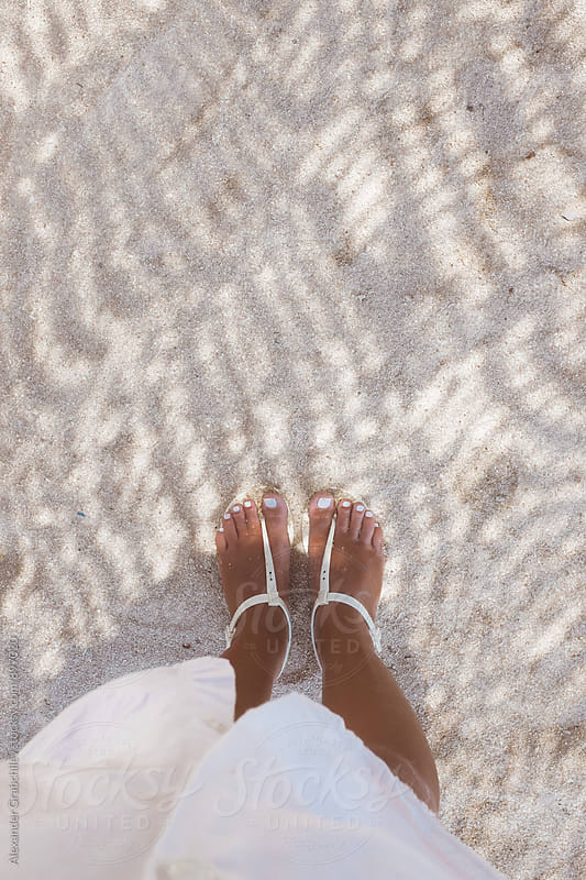 Feet On A Sandy Beach At Sunny Day by Alexander Grabchilev for Stocksy United