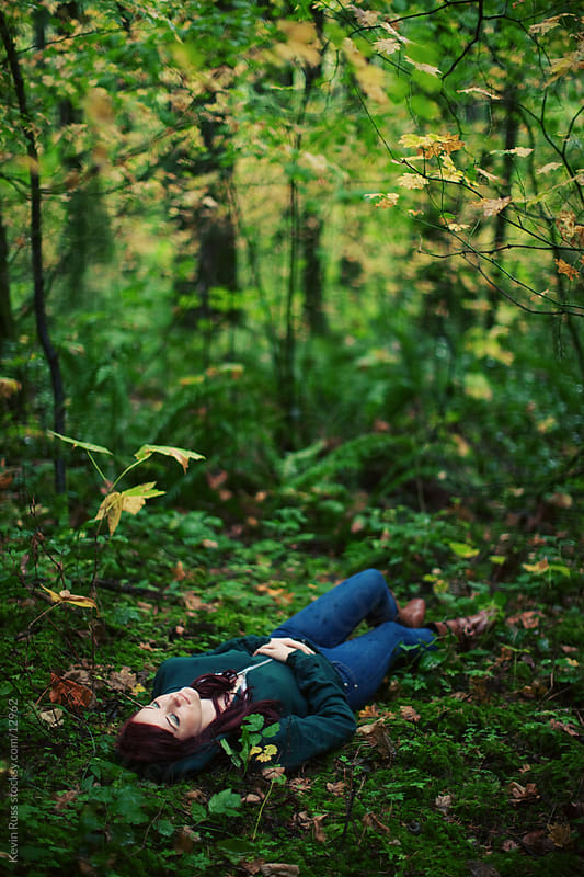 Woman Lays on Forest Floor by Kevin Russ for Stocksy United