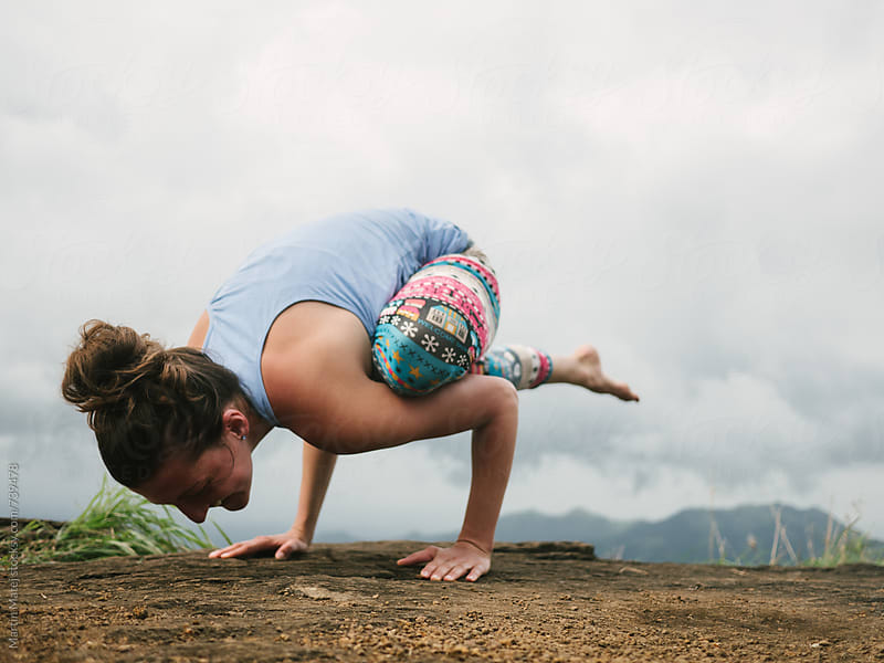 Yoga on top of mountain in tropics by Martin Matej for Stocksy United