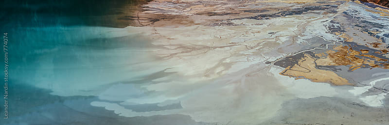 aeriel shot of an abstract looking lake  by Leander Nardin for Stocksy United