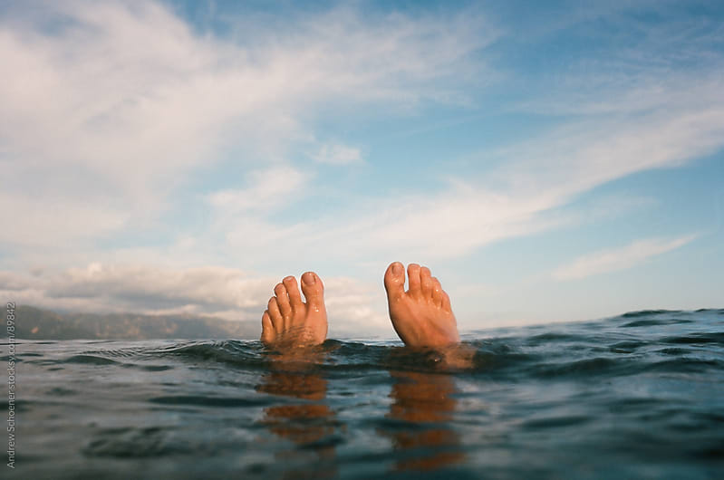 Feet Lounging in the Pacific by Andrew Schoener for Stocksy United