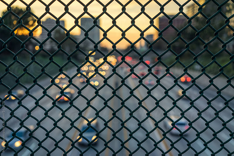 Fenced in away from the traffic by Mark Esguerra for Stocksy United