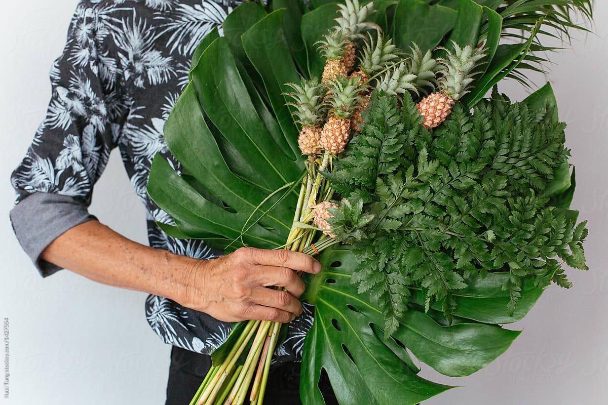 Senior Hipster Man Holding Tropical Plant Bouquet And Mini Pineapple ...