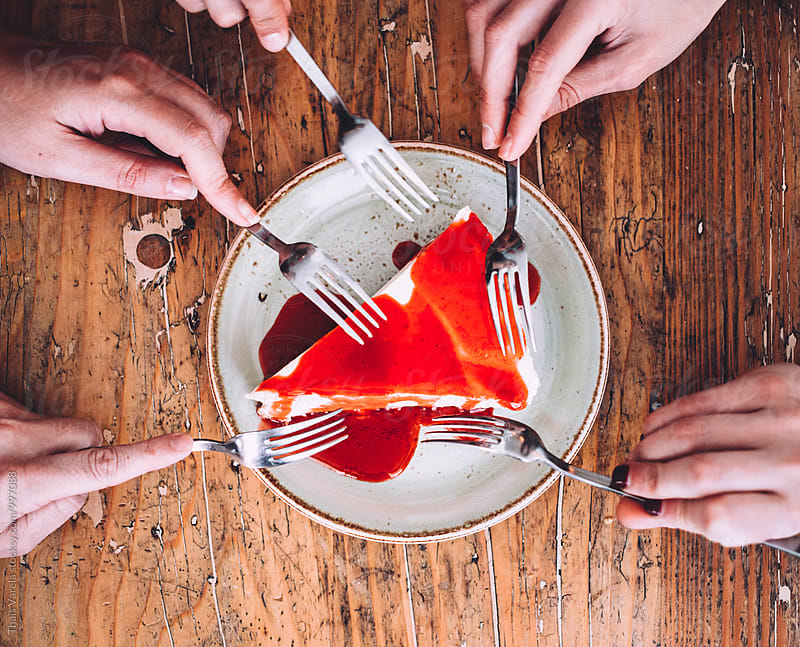 friends sharing a cheesecake by Thais Ramos Varela for Stocksy United