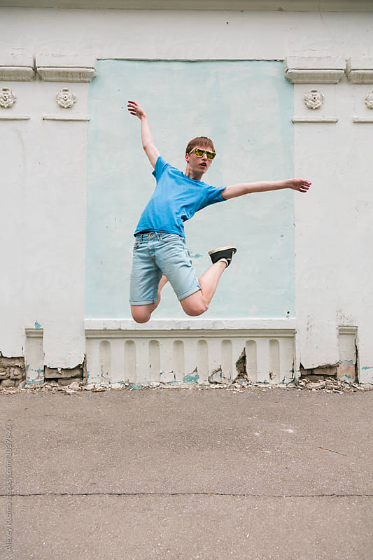 teen boy jumping by Alexey Kuzma for Stocksy United