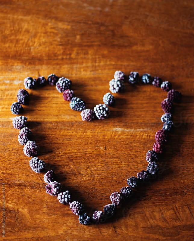 Frosted blackberries in a heart shape by Helen Rushbrook for Stocksy United