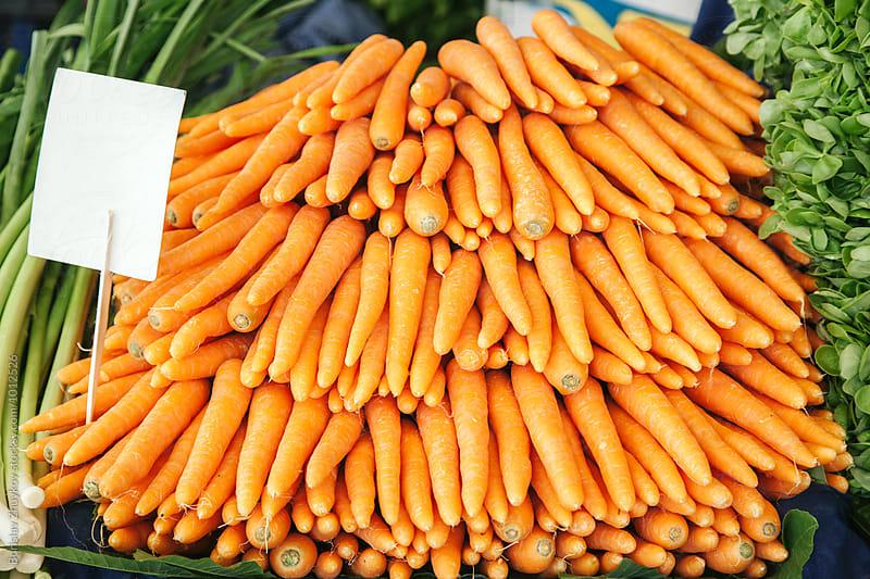 Carrots In farmer's market by Borislav Zhuykov for Stocksy United